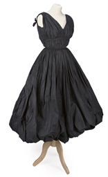A COCKTAIL DRESS OF BLACK SILK