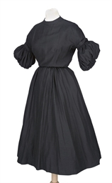 A COCKTAIL DRESS OF BLACK SLUB