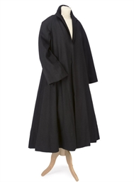 A VOLUMINOUS BLACK WOOL COAT