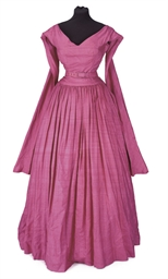 AN EVENING GOWN OF FUSCHIA PIN