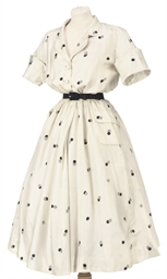 A WHITE SPOTTED SILK DAY DRESS