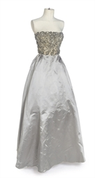 A SILVER SATIN EVENING GOWN