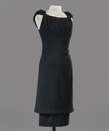 A COCKTAIL DRESS OF BLACK WOOL