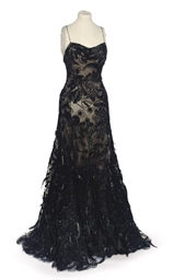 A BALL GOWN OF BLACK SILK CHIF