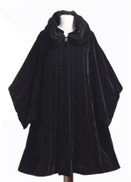 A BLACK VELVET CAPE WITH HOOD