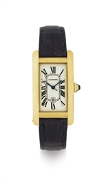CARTIER. AN 18K GOLD AUTOMATIC