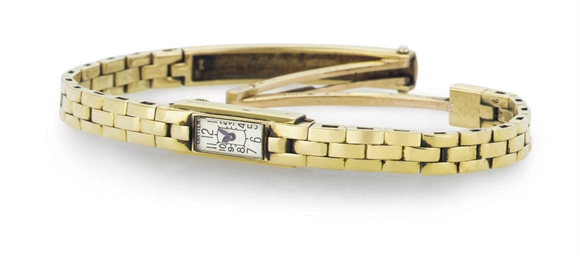 CARTIER. A LADY'S 18K GOLD MIN