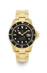 ROLEX.  AN 18K GOLD AUTOMATIC