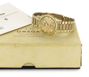 OMEGA.  AN 18K GOLD AUTOMATIC