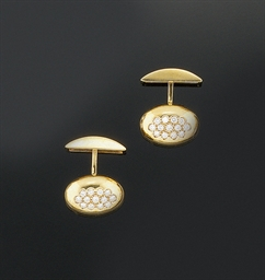 A pair of diamond set cufflink