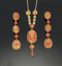 A coral cameo necklace and ear