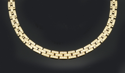 An 18ct. gold and diamond neck