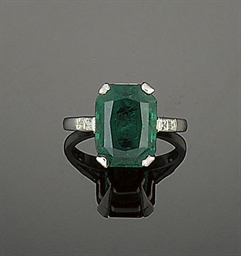 An emerald single stone ring