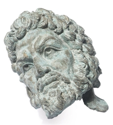 AN ITALIAN BRONZE BUST OF A MA