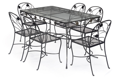 A GLASS-TOPPED STEEL TABLE