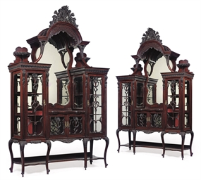 A PAIR OF CARVED MAHOGANY DISP