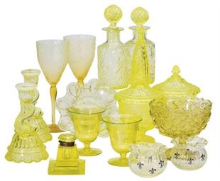 A GROUP OF VASELINE GLASS TABL
