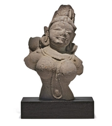 AN INDIAN SANDSTONE TORSO OF A