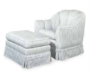 A BLUE AND WHITE UPHOLSTERED C