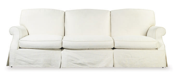 A CREAM UPHOLSTERED THREE-SEAT