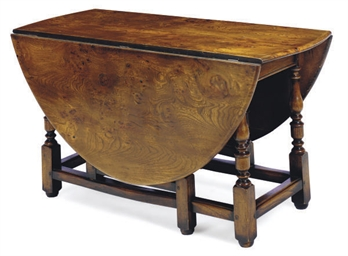 AN ELM DROP-LEAF DINING TABLE,