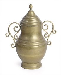 A BRASS COVERED URN
