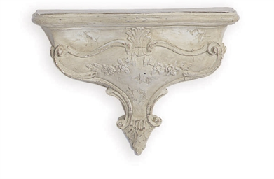 A PAINTED PLASTER WALL BRACKET