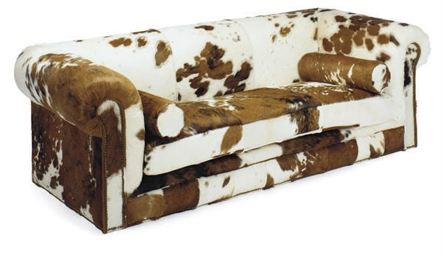A COWHIDE-UPHOLSTERED SOFA,