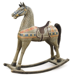 A PAINT-DECORATED ROCKING HORS