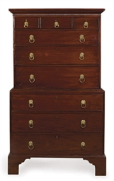 AN ENGLISH MAHOGANY CHEST ON C
