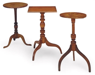 THREE STAINED WALNUT CANDLESTA