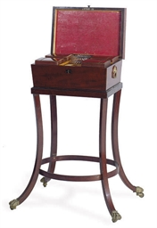 A REGENCY MAHOGANY TEA CADDY-O