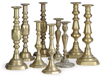NINE PAIRS OF BRASS CANDLESTIC