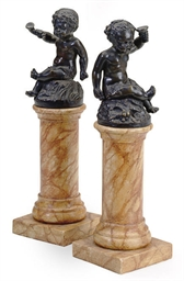 A PAIR OF PATINATED BRONZE PUT