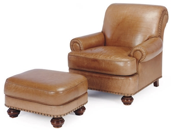 A BROWN LEATHER CLUB CHAIR AND