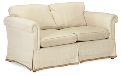A CREAM-UPHOLSTERED TWO-SEAT S
