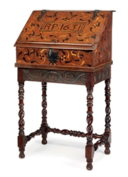 AN OAK AND MARQUETRY BUREAU-ON
