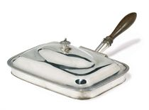 A GEORGE III SILVER TOASTED CHEESE DISH