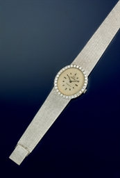 A diamond set wristwatch, by O