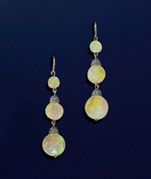 A pair of opal and diamond ear