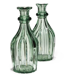 A PAIR OF GREEN GLASS DECANTER