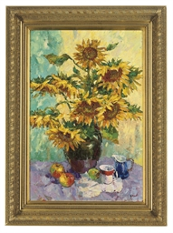 Sunflowers in a vase with frui