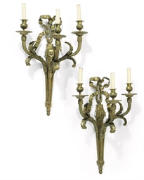 A PAIR OF BRONZE THREE-BRANCH