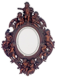 AN ITALIAN CARVED PINE MIRROR