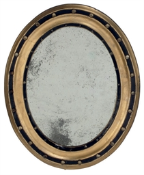 A PAIR OF OVAL MIRRORS