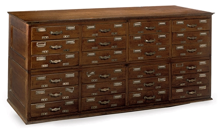 AN OAK TWENTY-FOUR DRAWER INDE