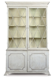 A WHITE PAINTED BOOKCASE