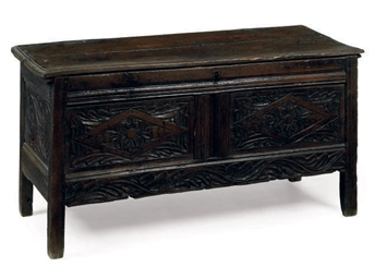 A CARVED OAK COFFER