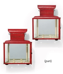 A SET OF FOUR RED-PAINTED TIN