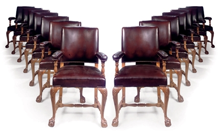 A SET OF FOURTEEN WALNUT ARMCH